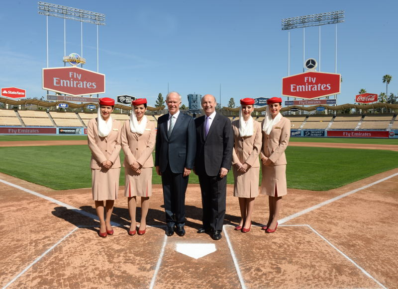 Emirates and LA Dodgers Press Conference - Home Plate Dodger Stadium. From left to right: Emirates Cabin Crew; Sir Tim Clark; Stan Kasten; Emirates Cabin Crew.