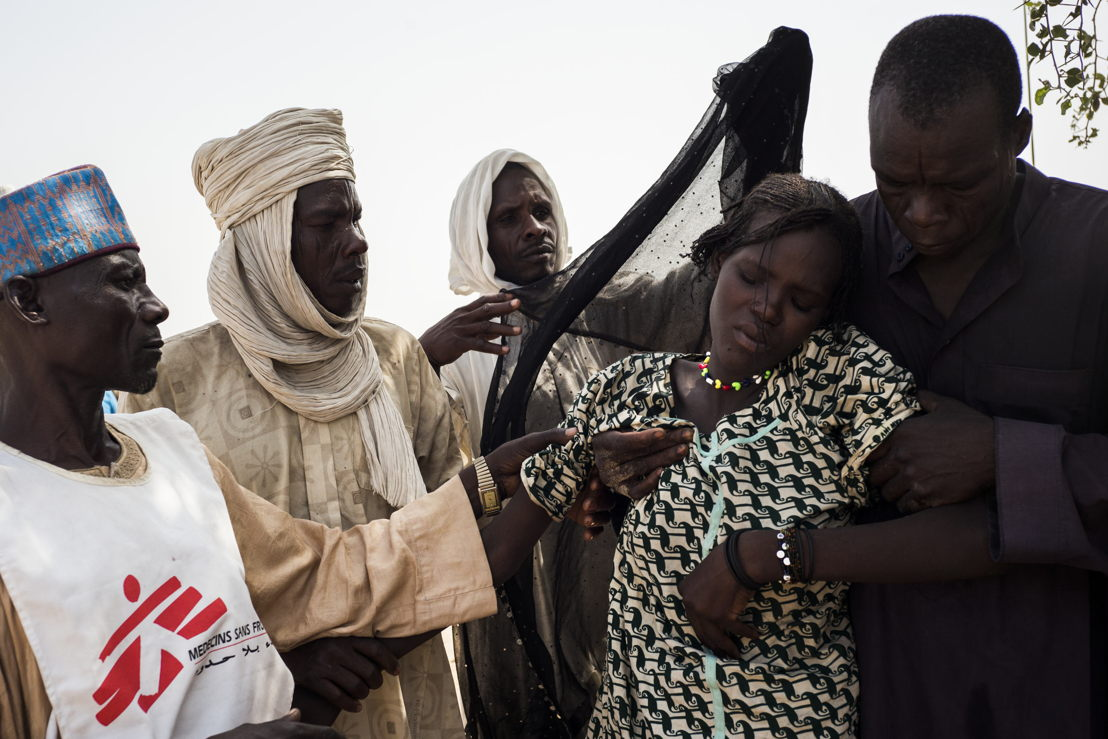 A young woman is carried to the MSF mobile clinic after travelling on a horse and cart for over 30km. She is being checked by MSF staff before being brought to the main hospital in Bol from Yakoua town. Photographer: Dominic Nahr