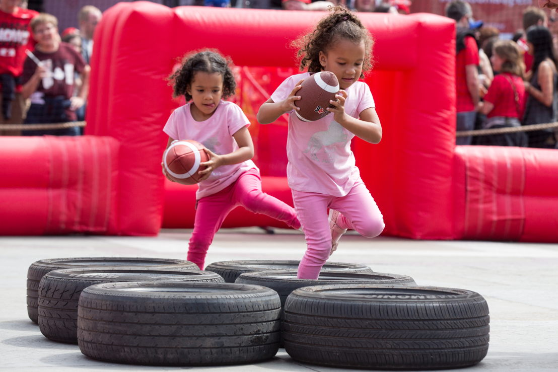 Youngsters going through the tire portion of the obstacle course. Photo Credit: Jim Ross/CFL