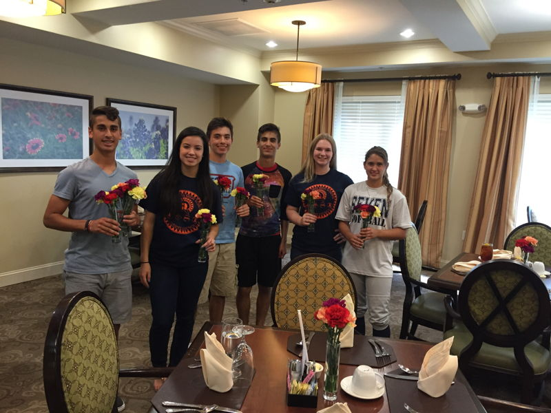 Students at Seven Lakes High School in Texas help out a local senior home during Flower Power.