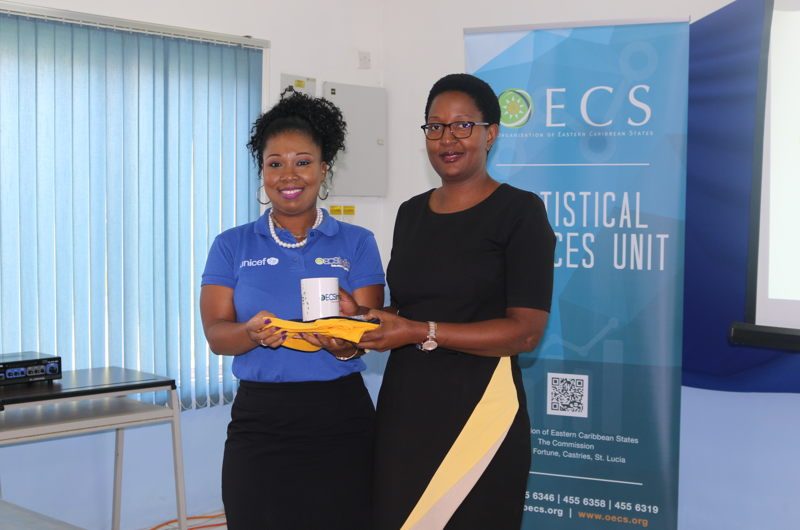 Ms. Abiola Sandiford, Information Officer in the Statistics Services Unit, makes presentation to UNICEF representative.