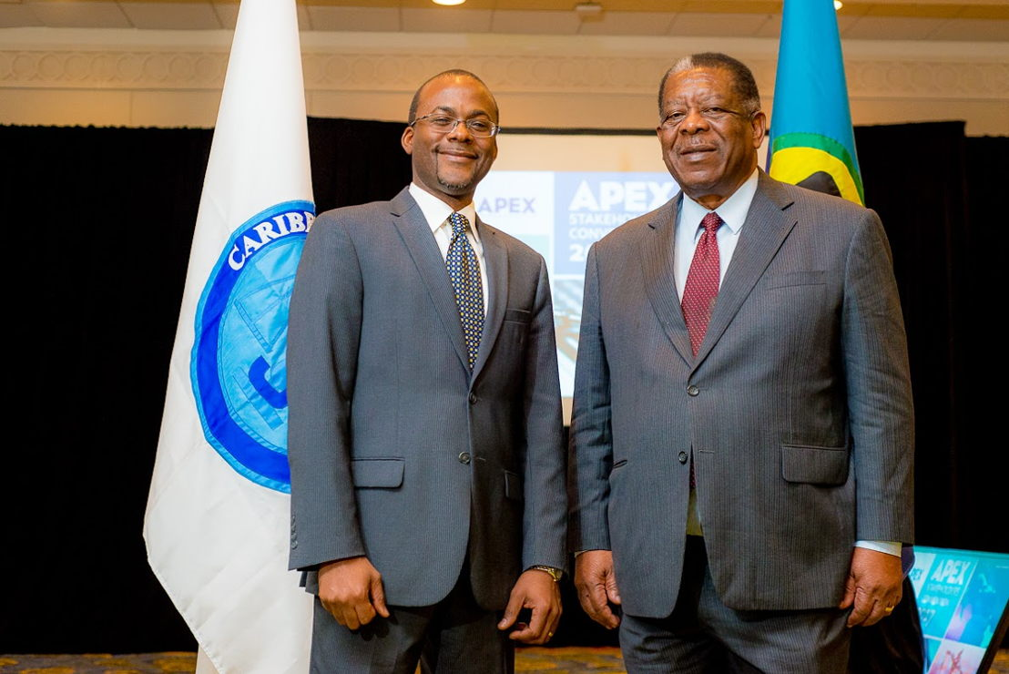 Executive Director of APEX, Bevil Wooding, with President of the Caribbean Court of Justice, Sir Dennis Byron.