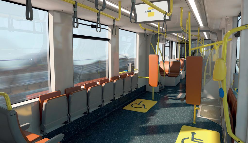 Interieur CAF-tram met klapstoelen en 2 rolstoelplaatsen.
