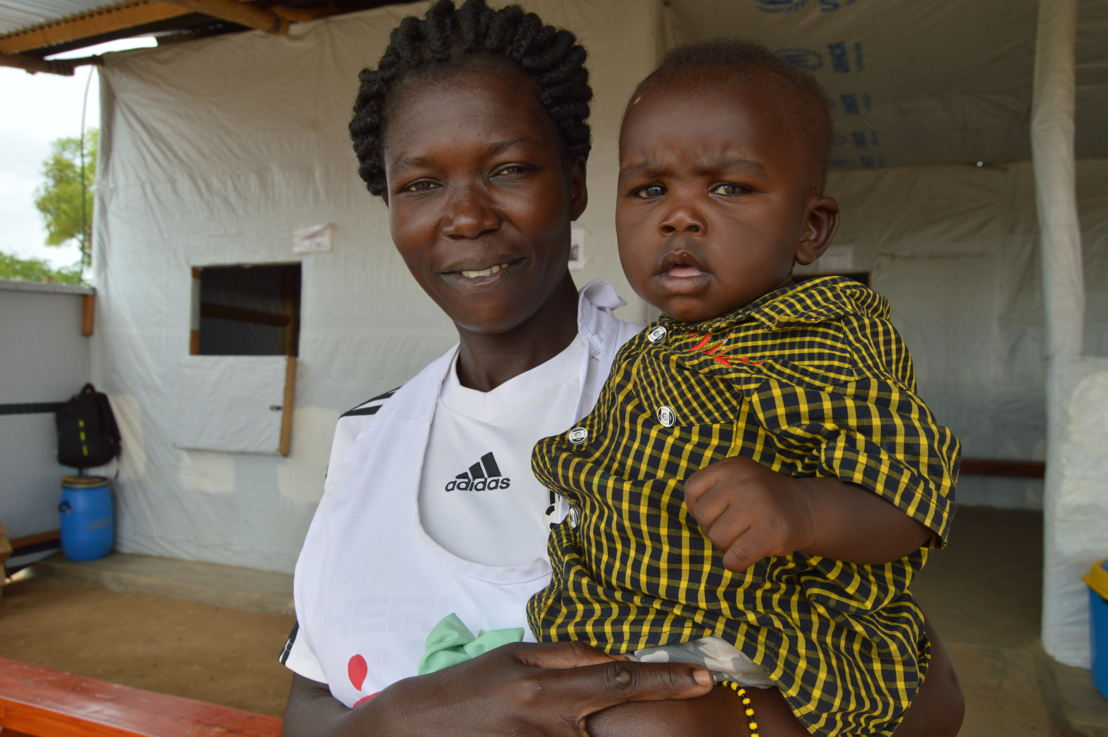 "Nola Aniba Tito, 27, is one of the medical translators working in MSF health centre in Ofua 3 zone, in Rhino settlement. Originally from a town in the Equatoria region, she fled violence in South Sudan in July 2016 with her children and started working with MSF in March 2017. As 86% of all South Sudanese refugees in Uganda are women and children, Nola is one of the many female head of households. In this photo she is pictured with her baby, Aaron.<br/>Full testimony from Nola: ""I was living with my two children and expecting another child. My husband was in Juba. In my neighborhood, everyone was fleeing because we were seeing child abduction, rape, looting, forced marriage, and killing between tribes almost every day. Schools were attacked and children slaughtered like chicken. If people from the other tribe come, they kill everyone from the other tribe and leave their own tribespeople. Moreover, there was no access to health care, especially after many NGOs left the country.<br/>One day, men knocked on the door of our house and threatened to open it. I was very scared so I didn't open it, but instead carefully opened the window and saw them holding guns. I cried and shouted so much that neighbors came and the men just left. That's when I decided to leave my home right away, without any belongings, just with my children and three of my brother's children, who hasn't been able to cross into Uganda. Even on the way to Uganda, there is fear of killing and violence and that is why my brother is still in South Sudan.<br/>I was lucky to make it to Uganda. But upon arrival in the camp, we found no water, no food, and no health services. Sometimes we had no water for more than a week. How can we live without any water to use and drink? I also had to walk a very long distance to the hospital outside the camp to deliver my baby, who is now seven months old. We left with nothing, not even a penny to buy food or to pay for transport to hospital. So the start of MSF health service. Photographer: Yuna Cho/MSF"