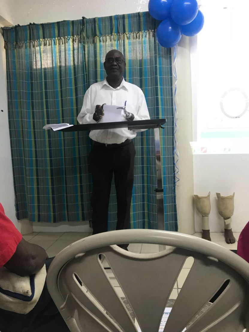 Course Facilitator and Prosthetic Technician Mr. Andrew Collymore  giving remarks