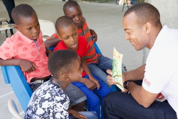 Rafer Gordon from the OECS EDMU reads to students as part of the USAID/OECS ELP