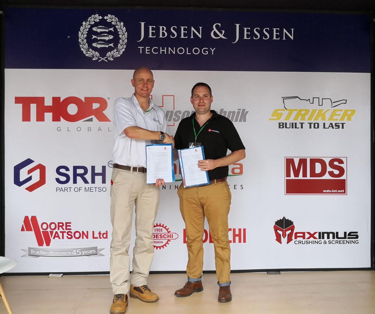 Michael Nielsen, President Director of Jebsen & Jessen Technology Indonesia signs partnership with Matt Beverley, Managing Director of Hoverdale UK