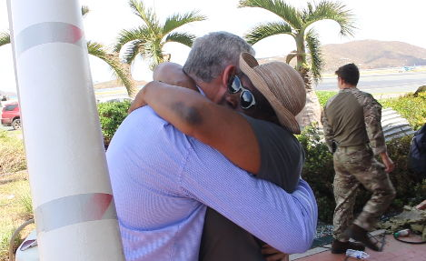 An emotional OECS national embraces Prime Minister Chastanet.