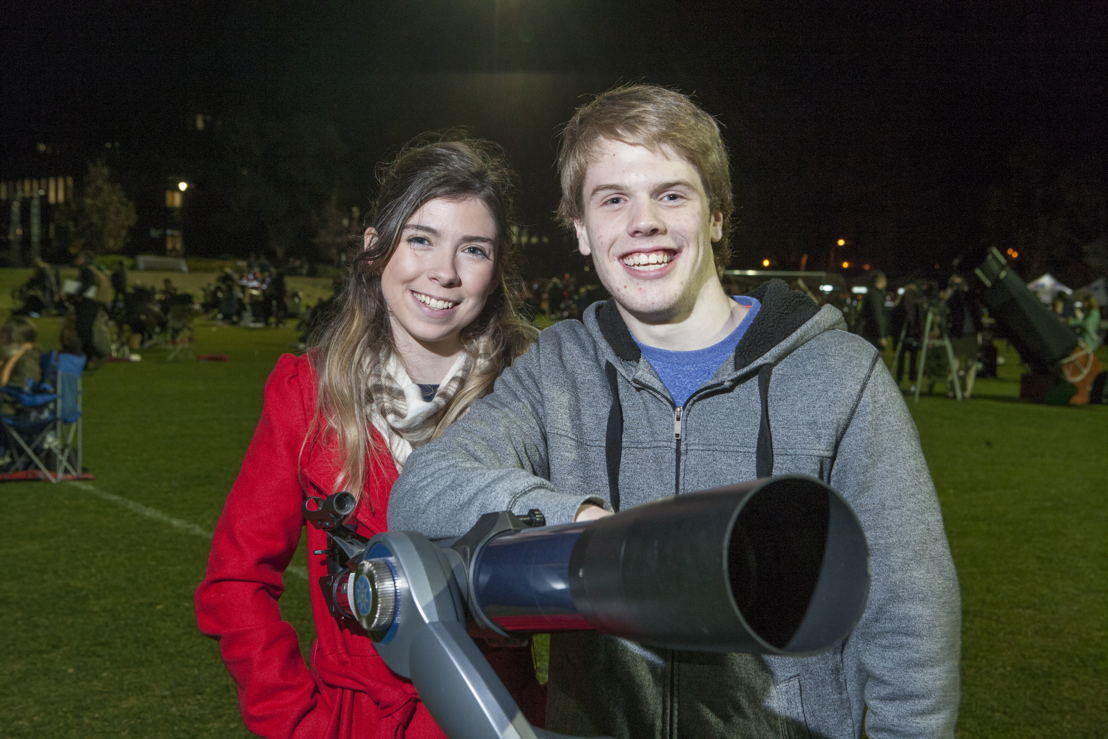 Kai and Heather were among the first people to arrive for the stargazing Guinness World Records title attempt at ANU. Image: Lannon Harley, ANU
