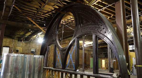 The original arch that graced the exterior of the Denver City Cable Railway Building waits to be moved to its new location behind the bar.