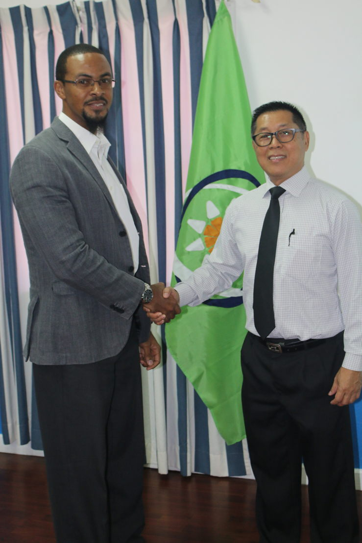 Programme Officer in the Trade Policy Unit at the OECS Commission, Mr. Cosbert Woods, with Captain Mark Heah of ST Electronics.