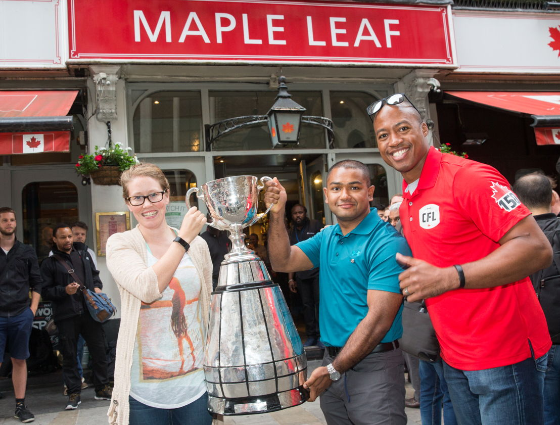 Master Seaman Smallwood, Master Seaman Kyaw Myint and Henry Burris outside the Maple Leaf Sports Bar and Grill. Photo Credit: Jim Ross/CFL