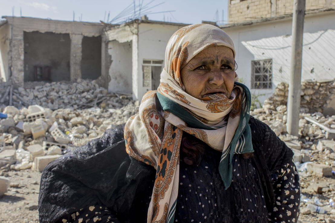"Amneh fled Al Mishlab, east of Raqqa city, with her family eight months ago. They moved five times before coming back as the front lines kept getting closer to their location. They came back to Al Mishlab to find that most of their houses have been destroyed. She is standing in front of her grandchild's house that was fully destroyed. She said ""we will try to rebuild our houses but there is still no services in the area yet."" Credit: Diala Ghassan/MSF"