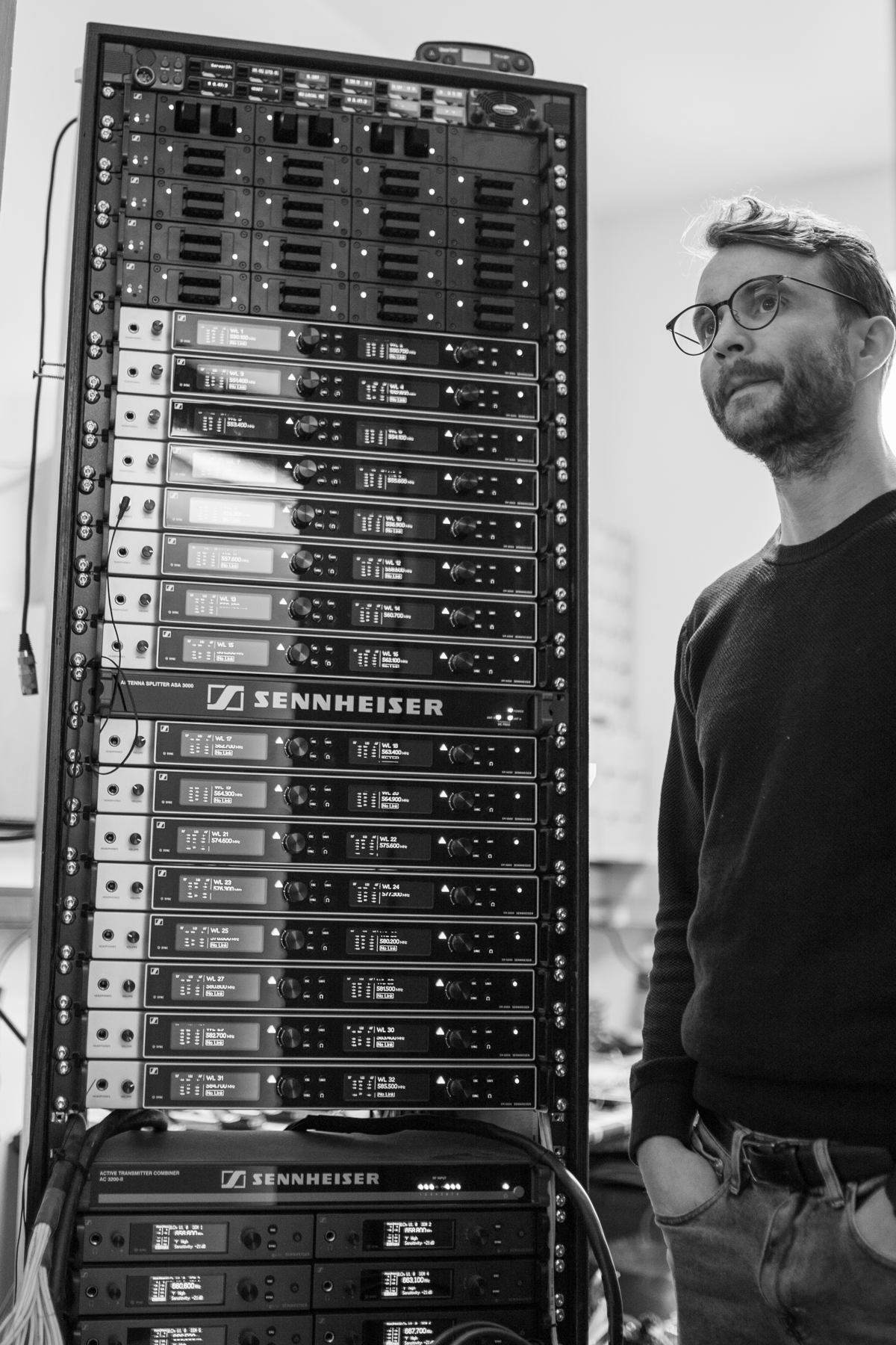 Kristinn Gauti Einarsson, Head of Sound at the National Theatre of Iceland, next to the Sennheiser Digital 6000 racks. At the top: L 6000 charging units, which can be fitted with the respective inserts for all transmitters in the Digital 6000 series