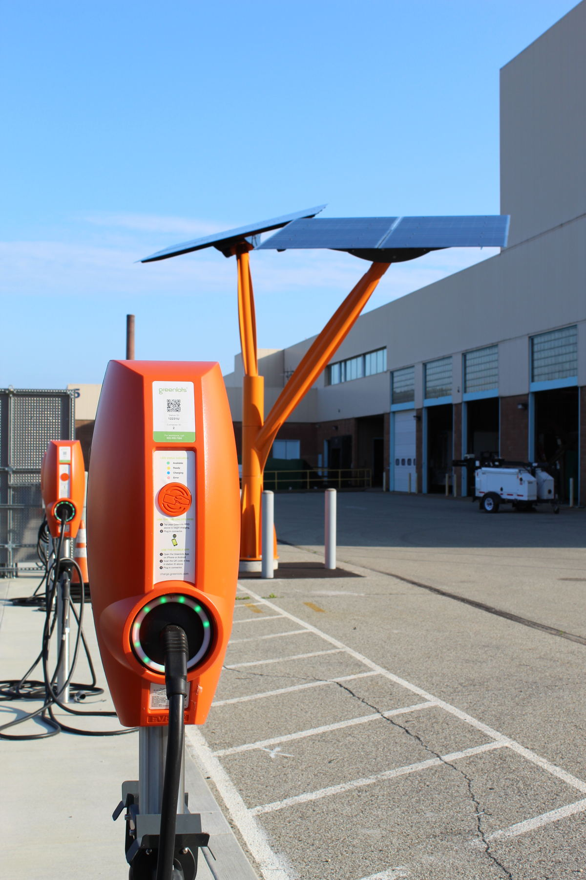 The campus' 20 EV chargers, which will be powered by the panels and tree, accommodate the company's growing electric fleet and employees who drive EVs.