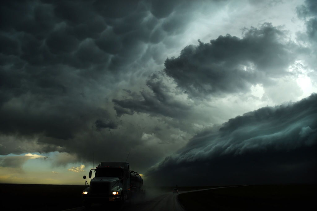 "Nick Moir, Fairfax Media, ""Gust Front 1 A truck drives away from the huge shelf cloud in western Kansas"""