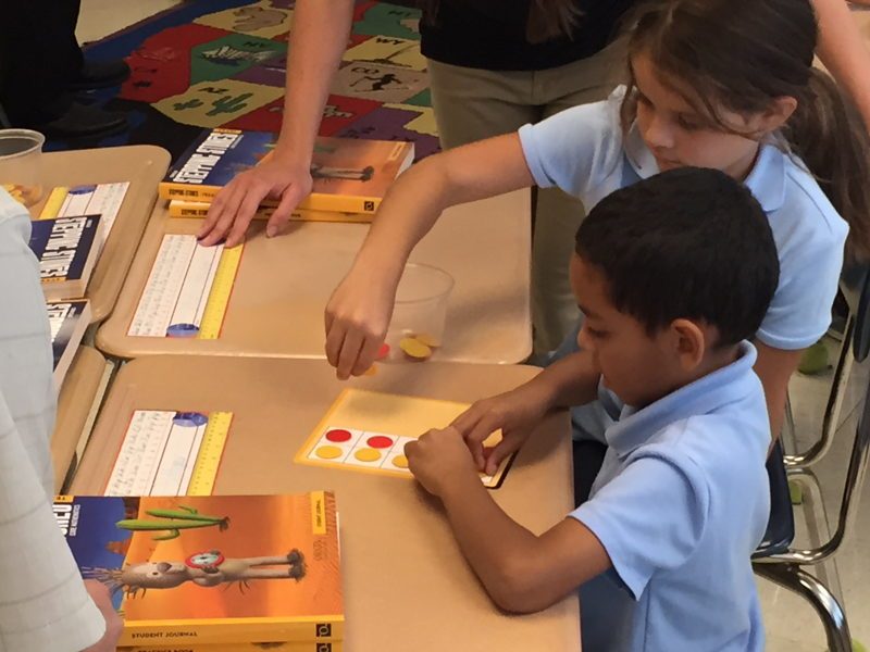 Kids use counters to add and subtract