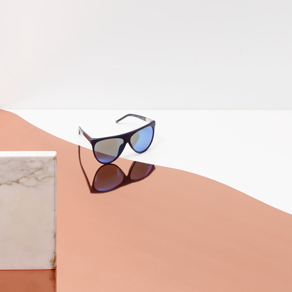 3.1 Phillip Lim - Navy acetate frame teamed with a blue stripe mirror lens