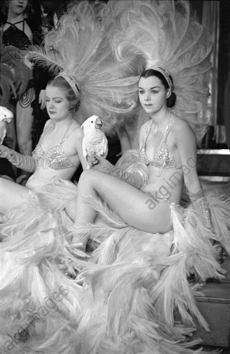 Rehearsal with showgirls and cockatiels at the Paradise Cabaret Restaurant, 49th Street and Broadway, New York –1936. Barto &amp; Mann were also on the bill.<br/>AKG1013905