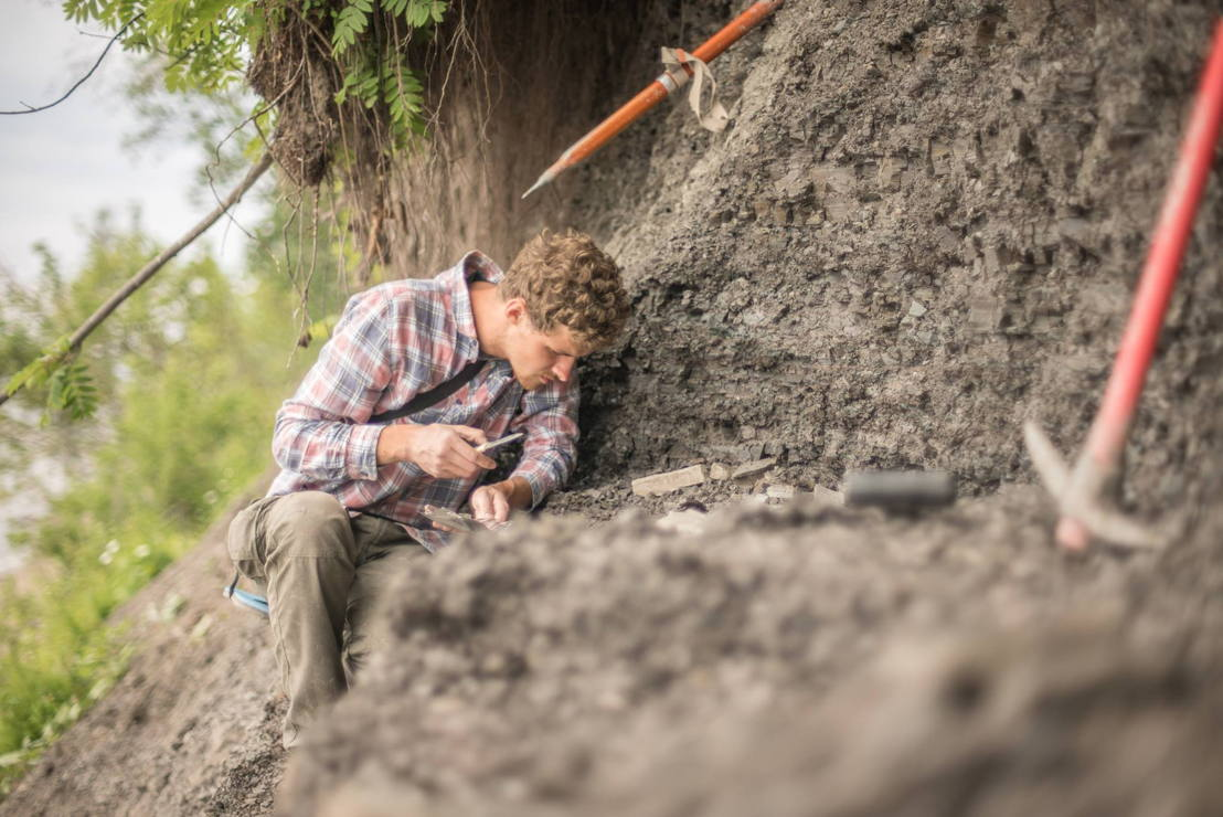 Lead researcher Ilya Bobrovskiy from ANU collects samples of the Ediacara biota from near the Lyamtsa village in Russia. Image: supplied