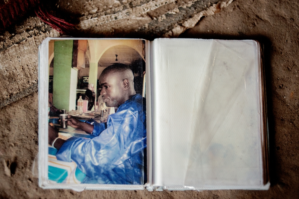"""MSF159644<br/>Photograph of Alima&#039;s son, Amousa who was 23 years old at the time of his death.<br/><br/>He was treated at the Red Cross Center after he became ill due to the living conditions in the camp.<br/><br/>Alima is trying to cope by relying on the help of other people living with her in the camp, as she and her husband are unemployed. """"We were born here, our parents and grandparents too... and now we are treated as strangers&quot;."""