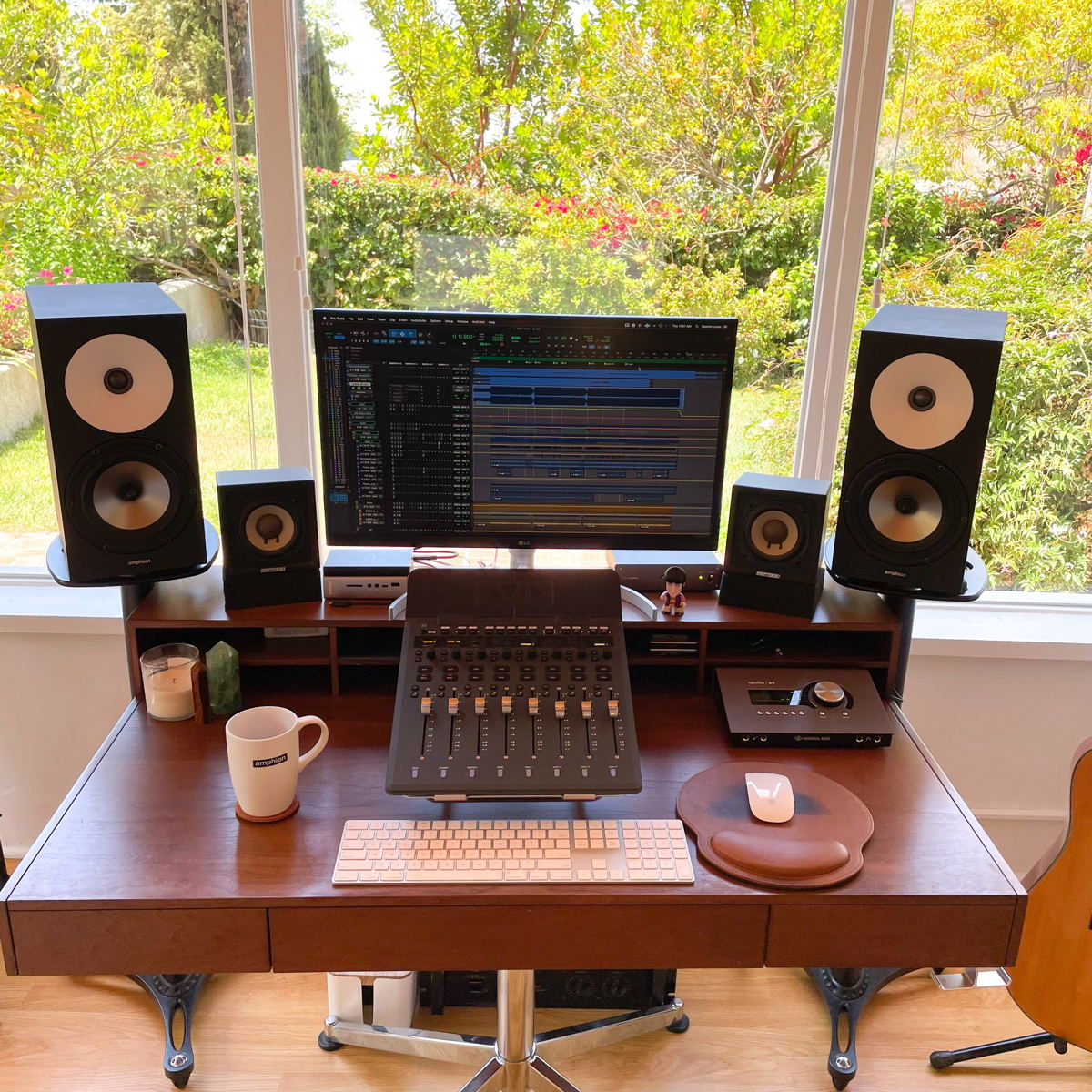 Lewis's home setup consists of a MacMini with an Avid S1 Control Surface, Apollo interfaces, and a variety of favored plugins in addition to his Amphion One18s and Amp700.
