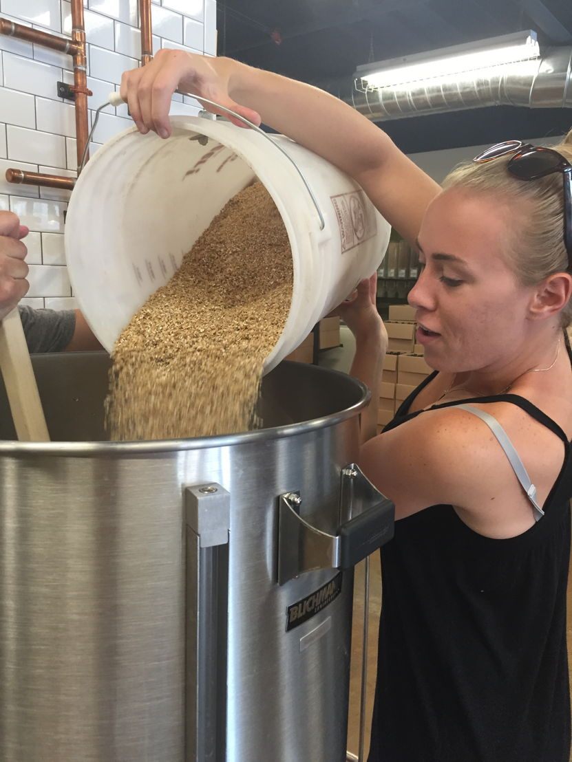 Grain is added to the mash during the brewing process