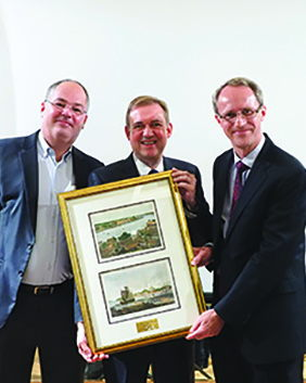 Group Chairman Heinrich Jessen and Non-Executive Director Peter Jessen present Hans Ulrich Hansen (centre) with a token of appreciation.