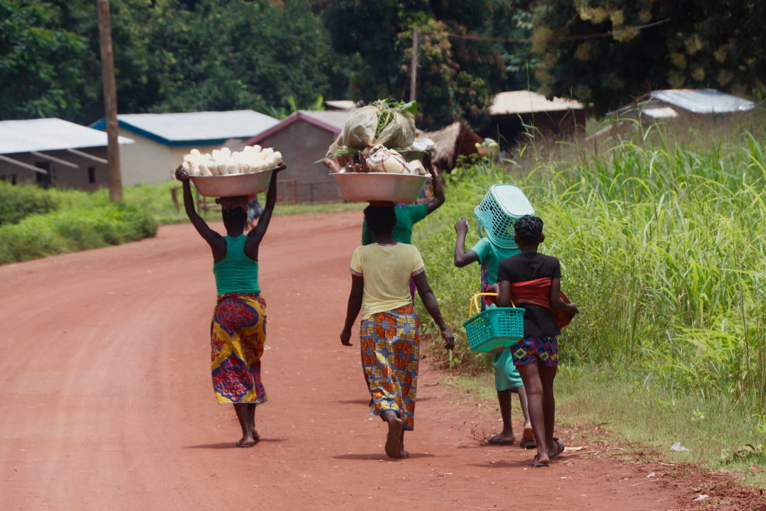 """Women walk by a """"Point Palu"""" located in Bossangoa's 3rd district. Photographer: Elisa Fourt"""