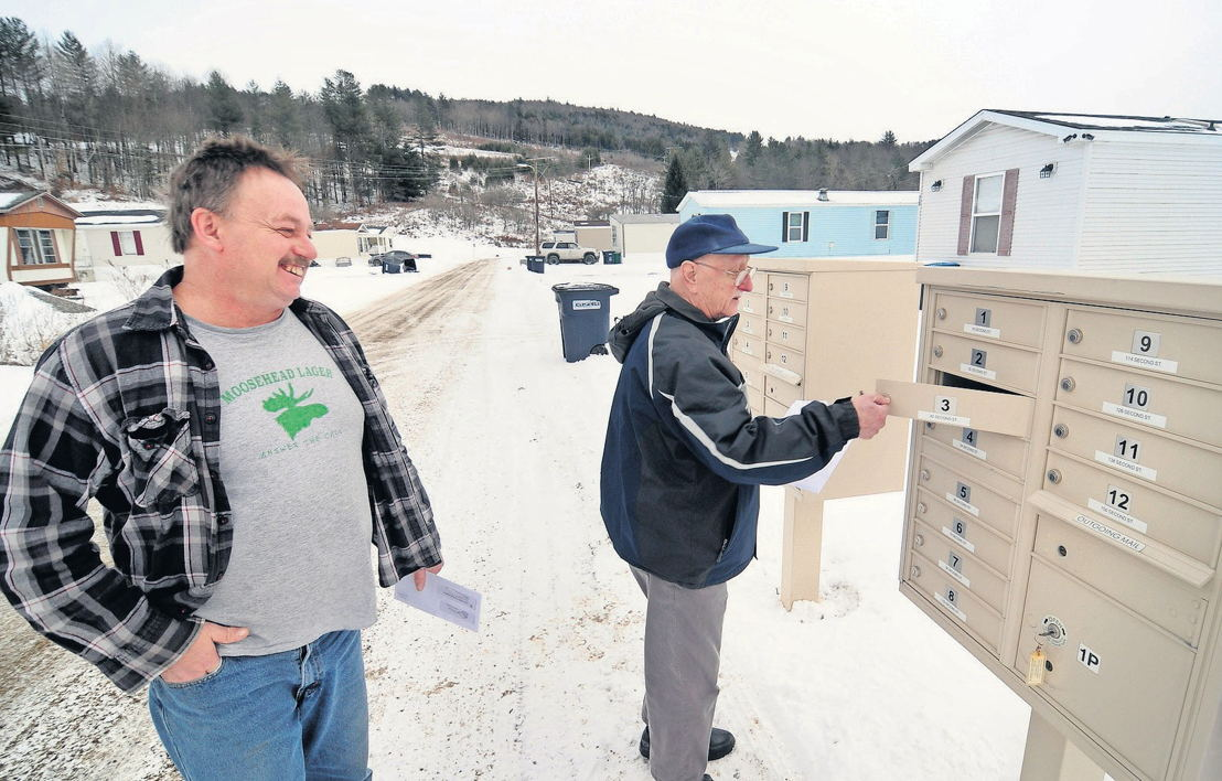 Neighbors Ronald Dickson, left, and Alston Douglass check their mail at Weston's Mobile Home Park in Berlin, where Dickson has lived two years, and Douglass has resided for 49 years. STEFAN HARD / STAFF FILE PHOTO