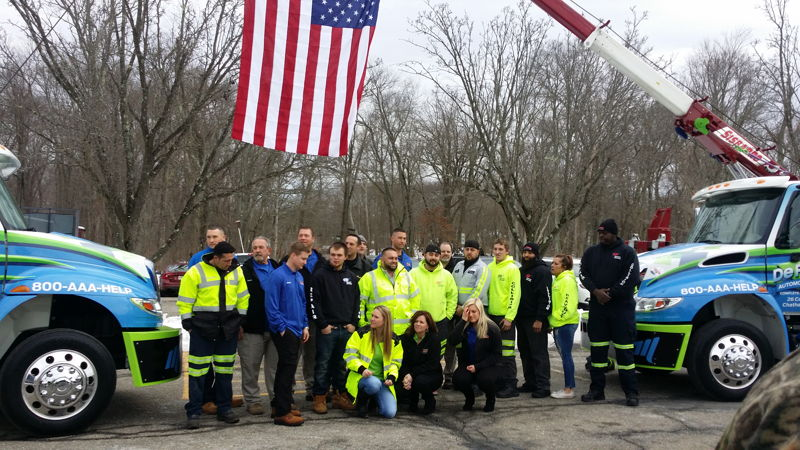 The Rempfer family and friends in front of the tow truck with Lung Cancer Foundation of America signage