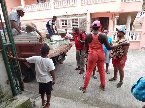 Grenada&#039;s Ambassador to the OECS H.E Dr. Patrick Antoine helps distribute relief in Grenada <br/><br/>Photo credit: Janeka Simon