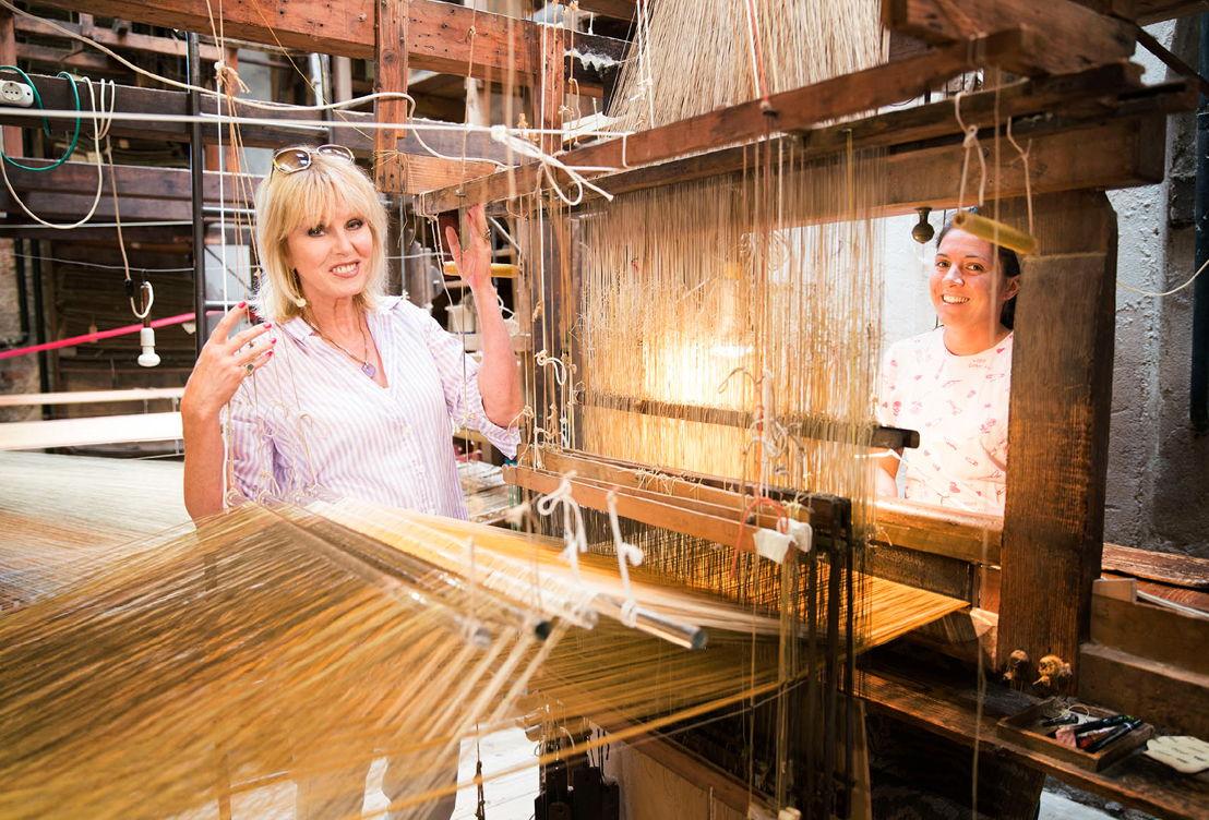 Joanna visits a factory that weaves silk thread