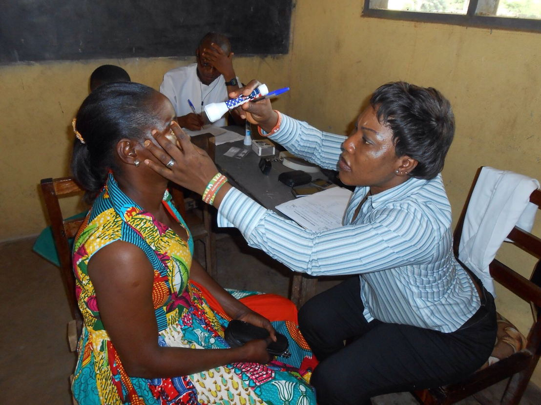 A villager from the rural Jaman North District is examined by an optometrist at the Sampa District Hospital. Changing Lives Together provided eye glasses for this poor rural district. The typical family earns $1 to $2 per day to feed 6-8 people. Unemployment estimates for the district are 70-80 percent.