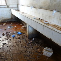 Sanitation area in a detention Center west of Misrata, ankle- deep urin and feces in the only place which inmates can use for washing and sanitation. No running water, no toilets or functioning showers at the time of visit.