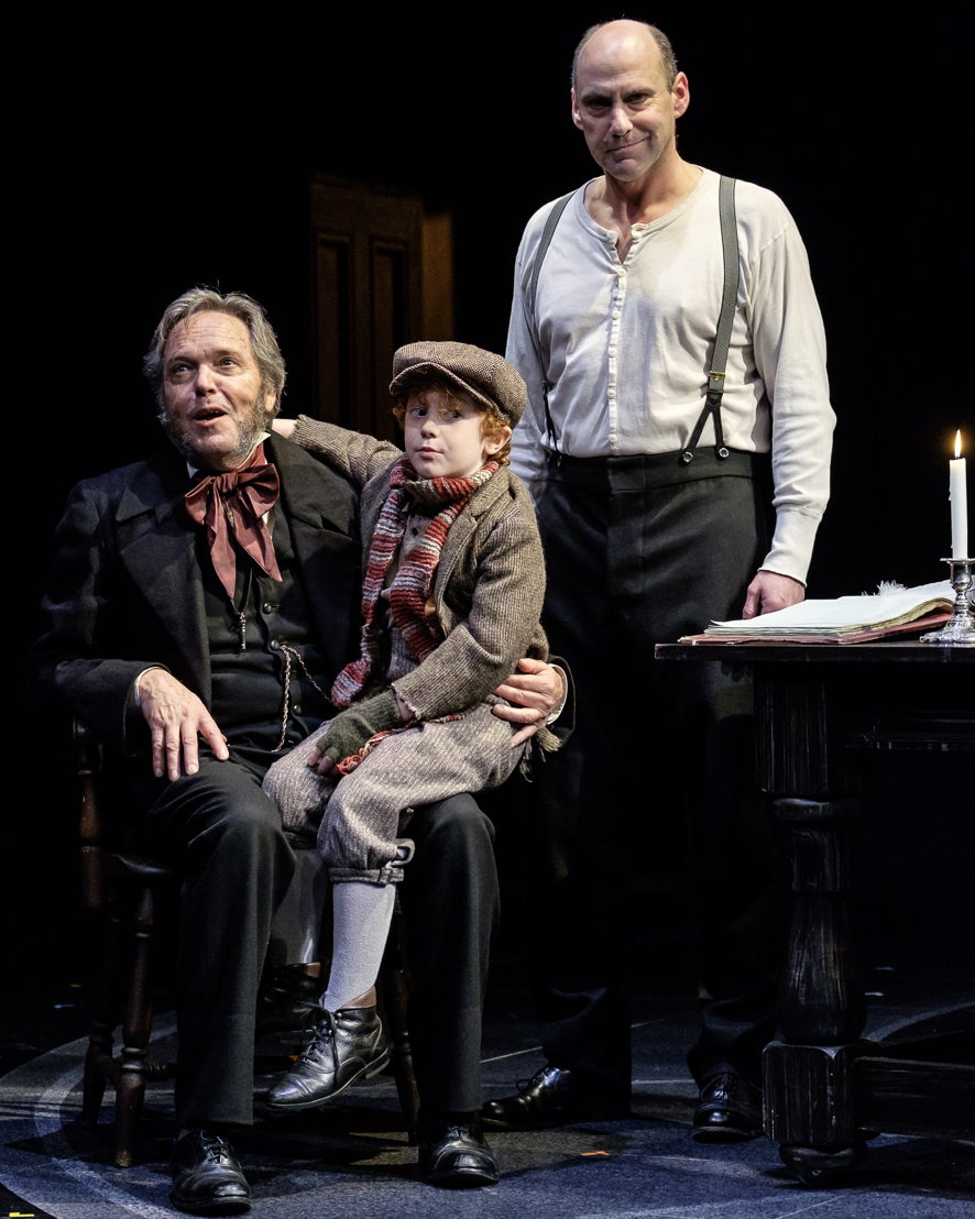 Tom McBeath (Ebenezer Scrooge), Kyle Atlas Stahl (Tiny Tim) and Gerry Mackay in A Christmas Carol / Photos by Don Craig