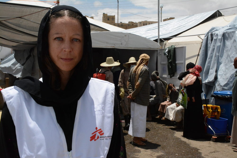 MSF project coordinator Claire Manera in front of MSF cholera treatment center in Khamer town, Amran. MSF is receiving an increased number of cholera patients in Yemen since the beginning of May 2017. This cholera treatment center alone, treated more than 1200 patients in less than two weeks. The center is still receiving an increased number of patients. Photographer: Malak Shaher/MSF