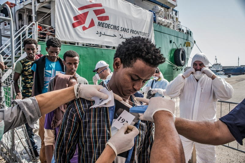 Photographer: Francesco Zizola<br/><br/>Caption: A refugee is numbered by the Italian authorities as people disembark the Bourbon Argos in Vibo Valentina, Calabria, Italy and queue to be registered.