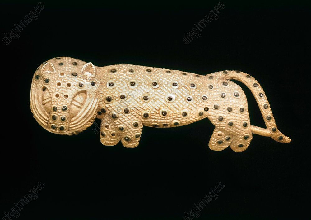 Jewellery in the shape of a leopard.<br/>part of the ceremonial dress of the Oba.<br/>West Africa, Edo, Benin, Nigeria,<br/>undated.<br/>Ivory and copper, length 28cm.<br/>Found in Benin City, Nigeria.<br/>London, British Museum.<br/>AKG593463