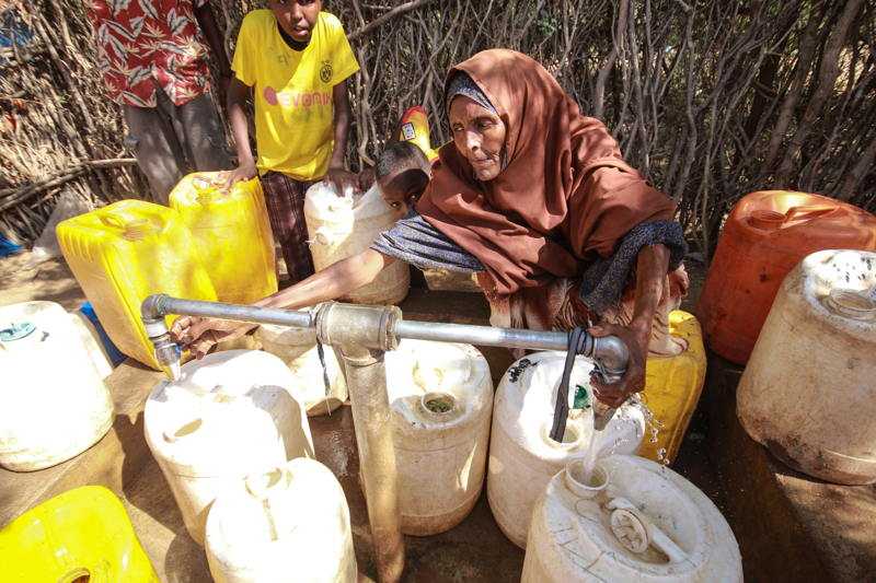 A woman fetches water at the water point in Dagahaley refugee camp, Dadaab, Kenya. Photographer: Tom Maruko
