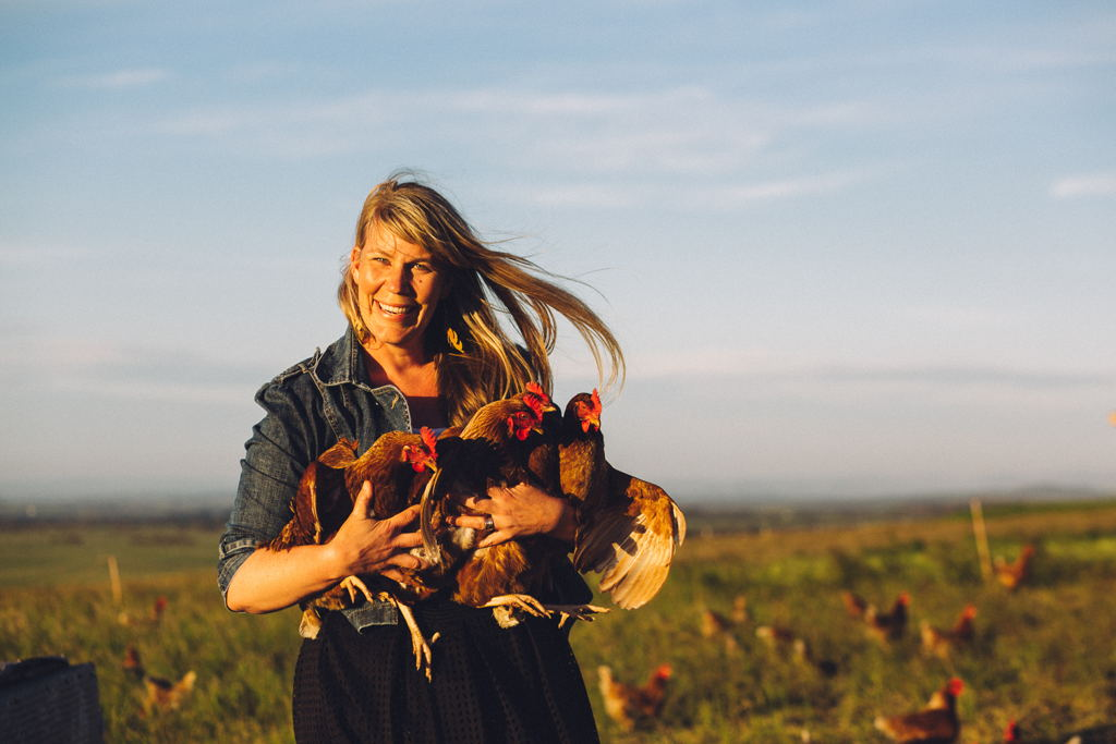 Amy Paul holding chickens at Ruby Hills Organics, Walkerville, 2016 | Source: Museums Victoria [MM 143586], Photographer: Catherine Forge