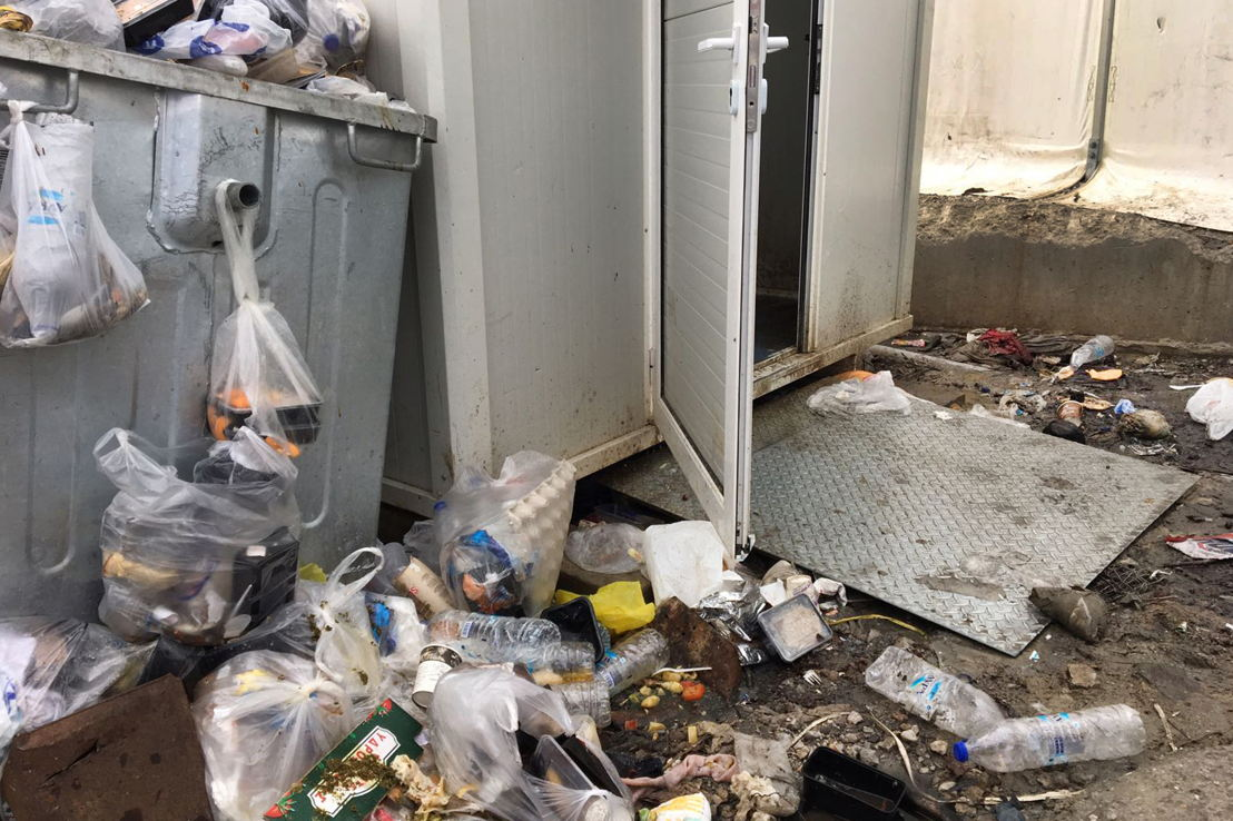 Entrance of one of the toilet containers in Moria camp. Credit: MSF