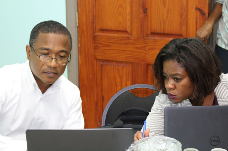 Representatives from the OECS Commission's Legal Unit provide advice to the Working Group.