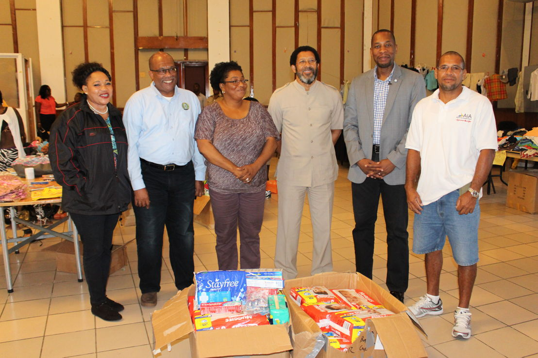 Governor, ECCB - Timothy N. J. Antoine (5th from left) with Deputy Governor, Trevor Brathwaite (2nd from left), ECCB Resident Representative for Antigua and Barbuda – Albert Lockhart (4th from left) and Coordinator and Volunteers at Hurricane Shelter, Antigua.