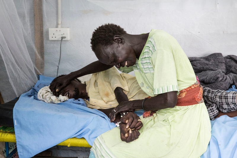 A woman grieves for her sick relative in MSF's hospital in the UN compound in Malakal, South Sudan. Photographer: Anna Surinyach/MSF