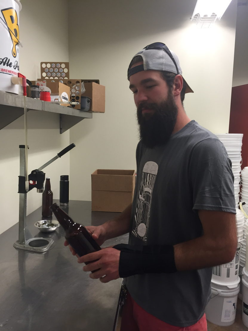 William Brant of CO-Brew bottles the beer