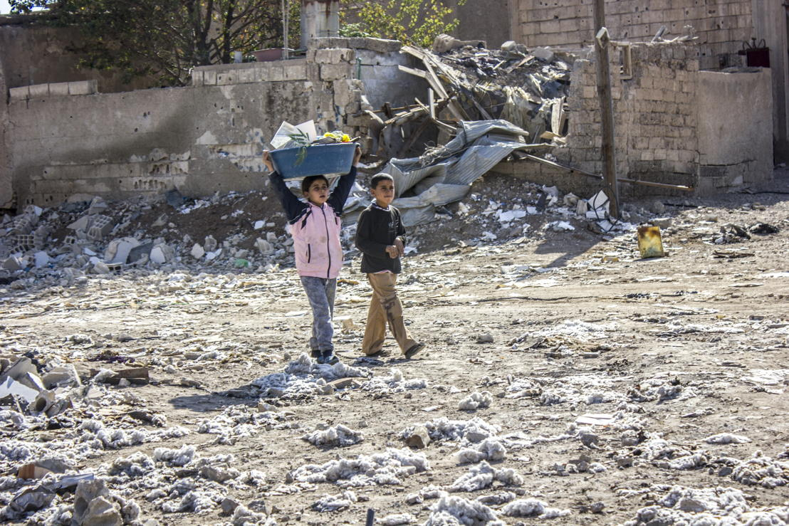 Two children help their parents clean their house of rubble. Al Mishlab, east of Raqqa city, 7 November 2017. Credit MSF/Diala Ghassan