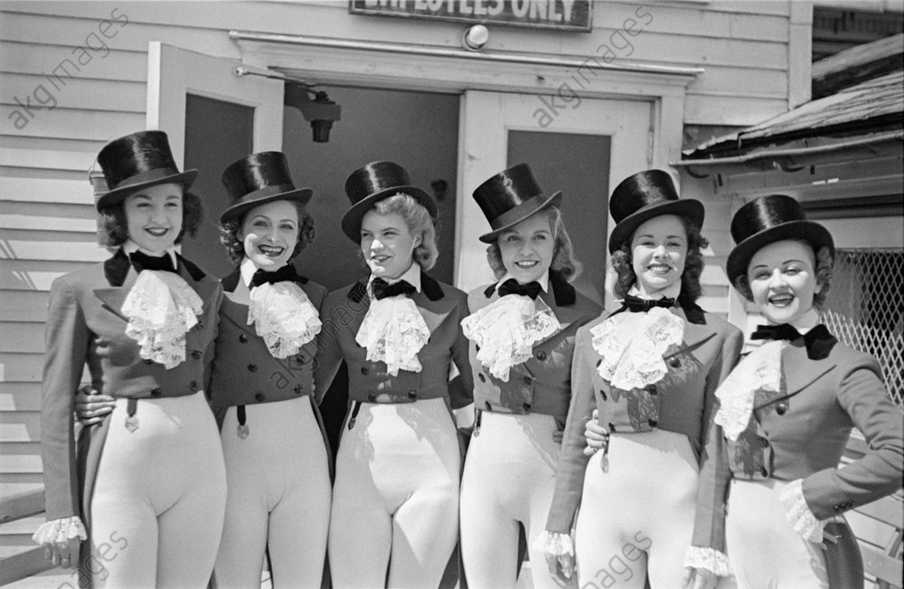 """Paradise Cabaret revue dancers standing under """"employees only"""" sign. Barto and Mann were also on the bill.<br/><br/>Photo, New York, 1937.<br/><br/>AKG1013734"""