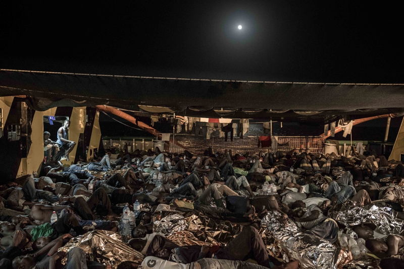 Photographer: Christophe Stramba-Badiali<br/><br/>Caption: 533 people sleep on the deck of the Borbon Argos after being rescued at sea by Doctors Without Borders (MSF) in the Mediterranean.