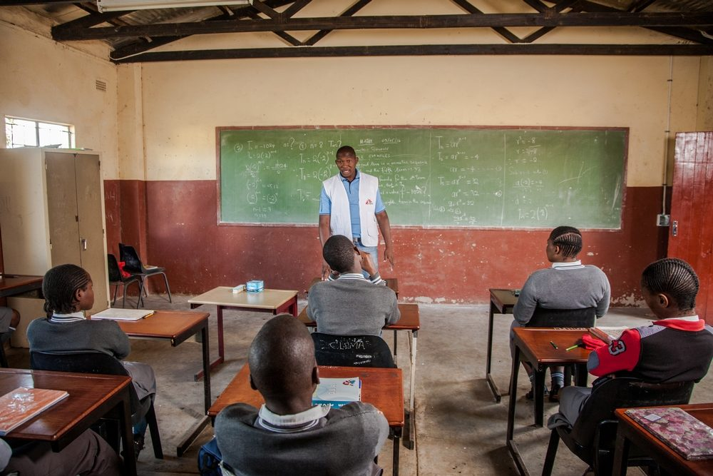 Doctors Without Borders (MSF) Lay Counsellor Nkosinathi Mpungose delivers a HIV health talk to learners of Hhashi High School in ward 1 of Uthungulu District, Umlalzi Municipality Eshowe. The learners will be given the opportunity to sign up for HIV testing at the Mobile 1-Stop Shop (M1SS) parked on the school grounds. MSF's Mobile 1-Stop Shop has travelled to dozens of schools, colleges and local sporting and cultural events to deliver HIV Counselling and Testing to people of all ages in rural KwaZulu-Natal, the South African province with the highest prevalence of HIV infection. Photographer:  Greg Lomas / Médecins Sans Frontières